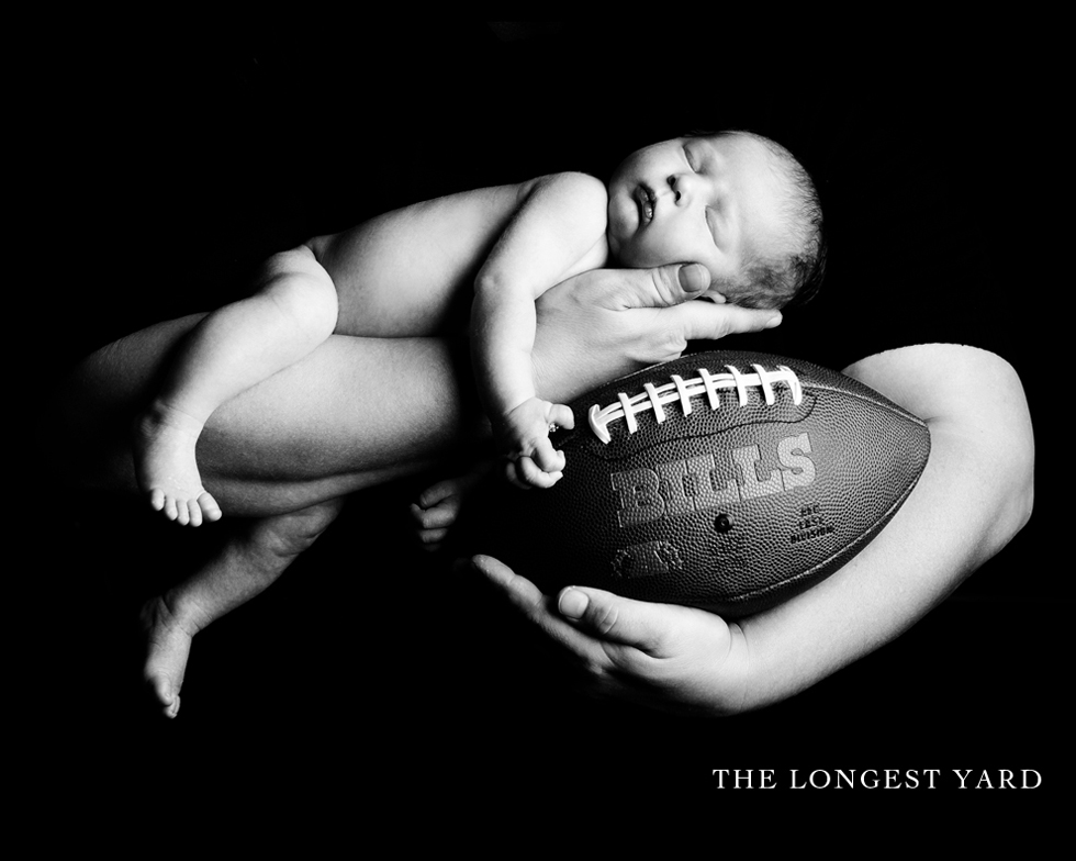 Newborn baby with football